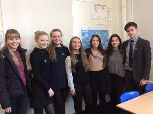 Students from Prior Park College wearing their handmade green hearts.