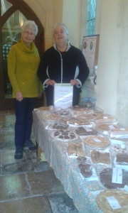 Angela Middleditch and friend with all the cakes at the start of the sale.